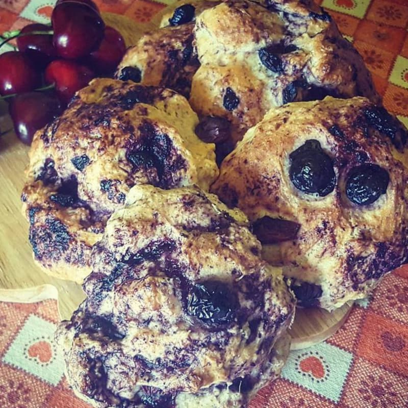 Sweet muffins with blueberries and cherries