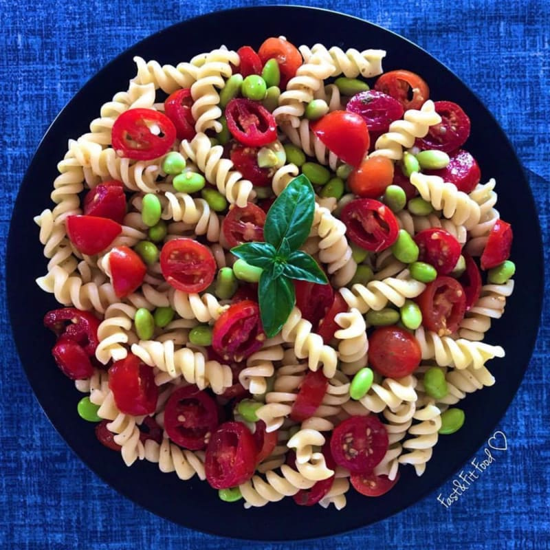 Cool vegan pasta with cherry tomatoes and edamame