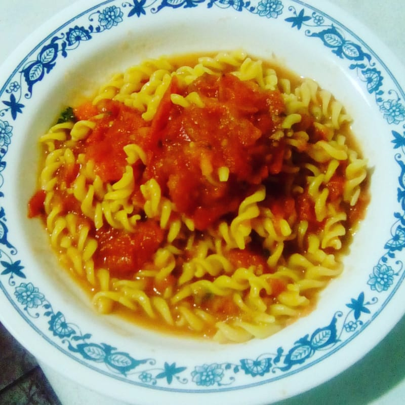 Fusilli with corn rice, accompanied by homemade tomato sauce