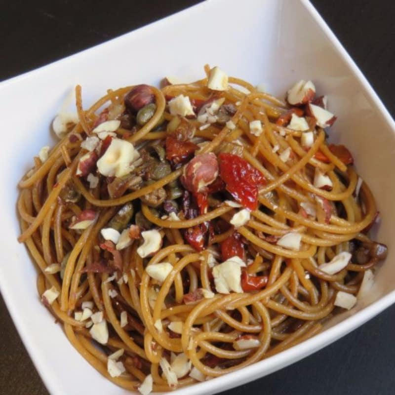 Spaghetti with espresso sauce, capers and cherry tomatoes