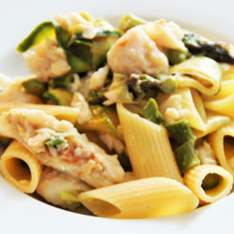 Penne with vegetables and hake