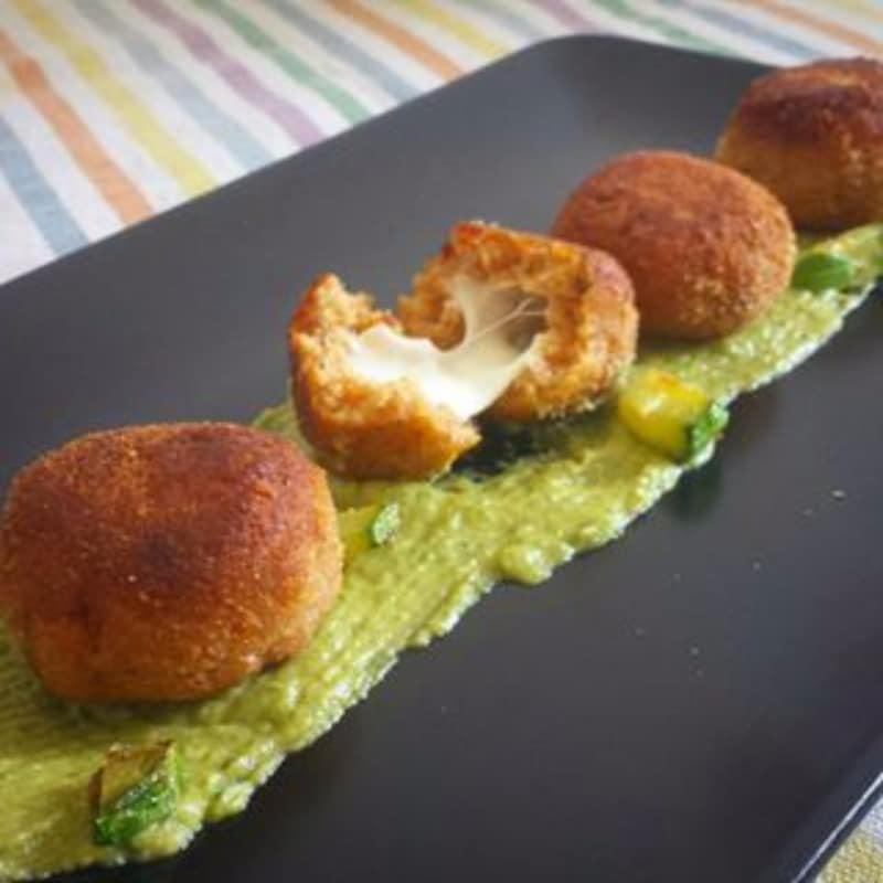 Dumplings of spiced bread from the flowing heart on zucchini sauce