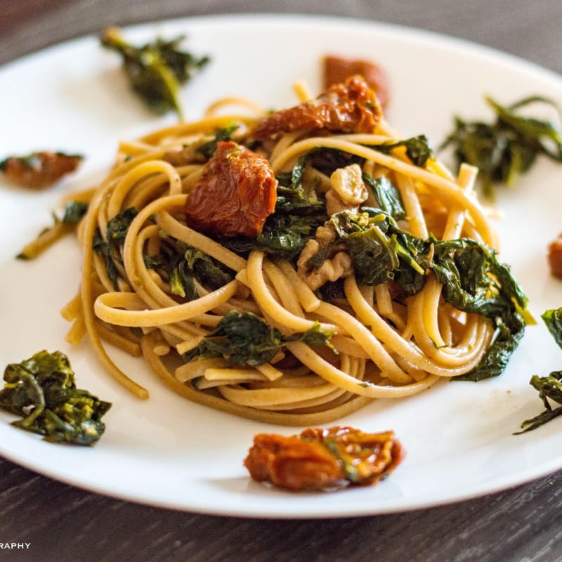 Whole-grain linguine with turnip tops, sun-dried tomatoes and walnuts
