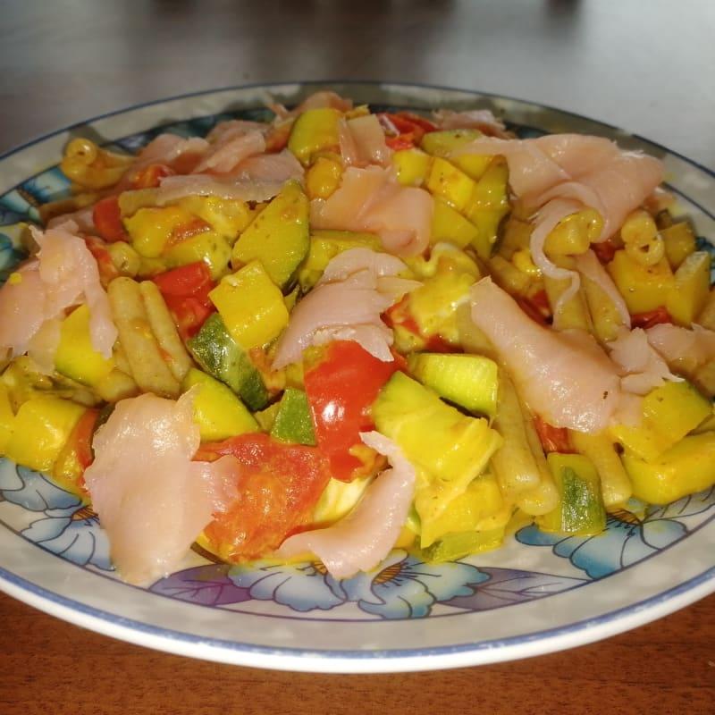 Whole homemade caserecce with zucchini, cherry tomatoes, stracchino and salmon