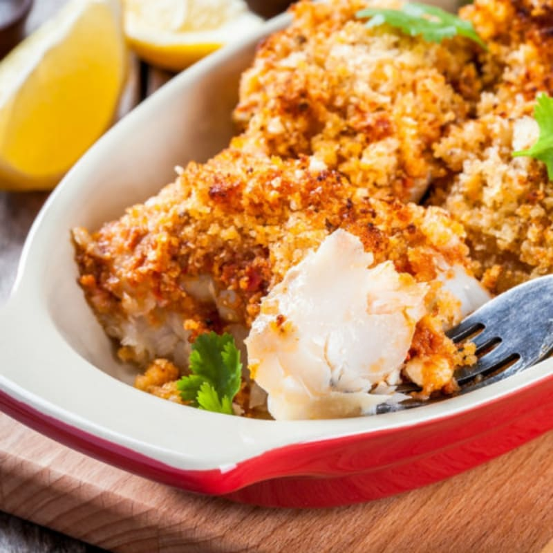 Baked cod with breadcrumbs, almonds and dried tomatoes