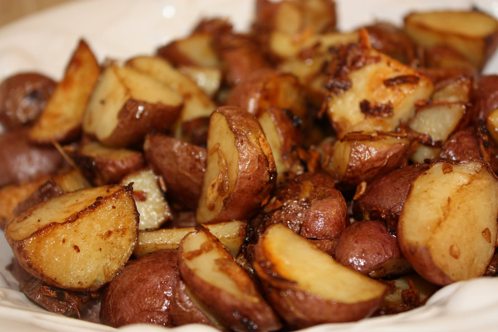How long to cook cut up red potatoes in oven