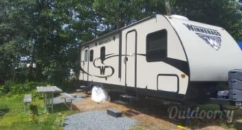 Your Campfire Awaits at this Winnebago setup at the Bar Harbor Oceanside KOA
