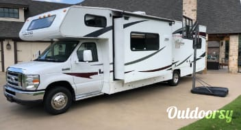 The Holmes' Rollin' Home ~ 2012 Coachmen Freelander (32', Sleeps 10+)