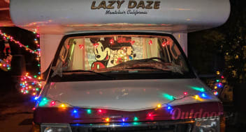 Red Lazy Daze King memory foam topped bed, Easy-driving, Seats 10, Sleeps 4-6.  Traveling, Camping, and Party Bus!