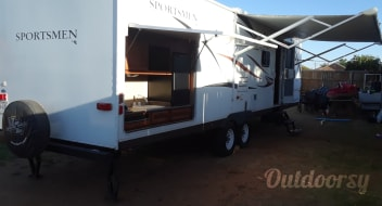 SHOWSTOPPER with Kuerig coffee maker, Amazon Prime,Blutooth speakers inside/outside, USB ports, outdoor kitchen with table and four chairs, too many EXTRAS to list. Scroll through our page and see for yourself and save some $.