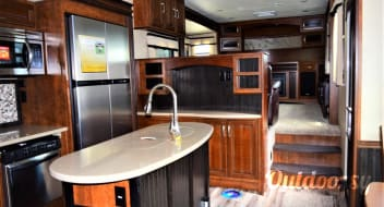 2015 Grand Design Solitude-Parked at Wisconsin Lake Campground for all season. No towing!