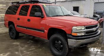 Red Chevrolet Suburban Overland