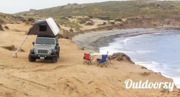 Jeep Wrangler Overlander with Roof Top Tent and camping equipment