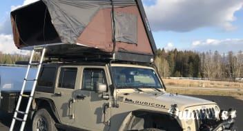 2017 Jeep Rubicon Package with iKamper Roof Top Tent.