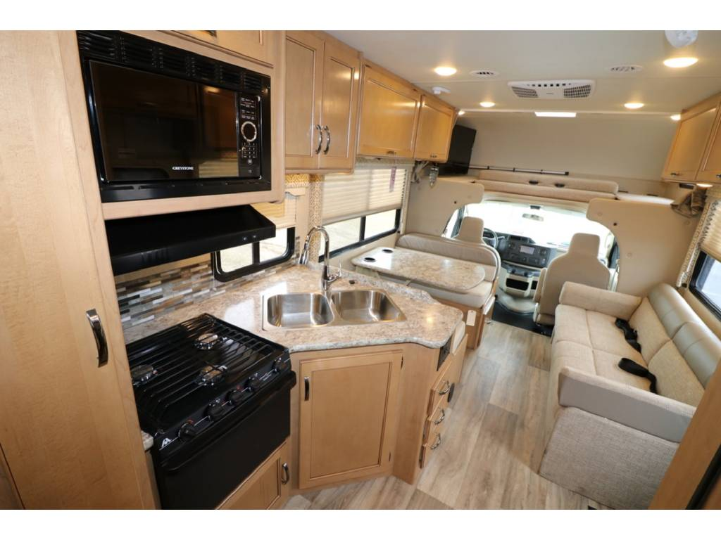 Well equipped kitchen with stove,  oven,  microwave,  double sink,  and refrigerator/ freezer. . Thor Motor Coach Freedom Elite 2017