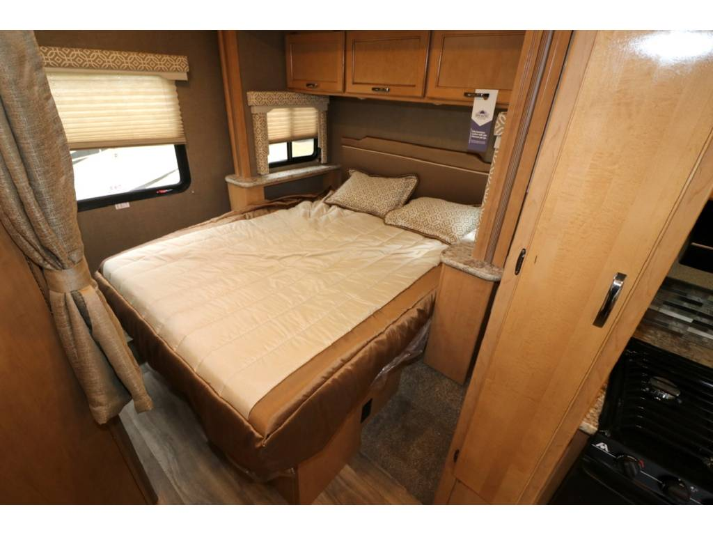 Queen size bed in slide out for greater space. . Thor Motor Coach Freedom Elite 2017
