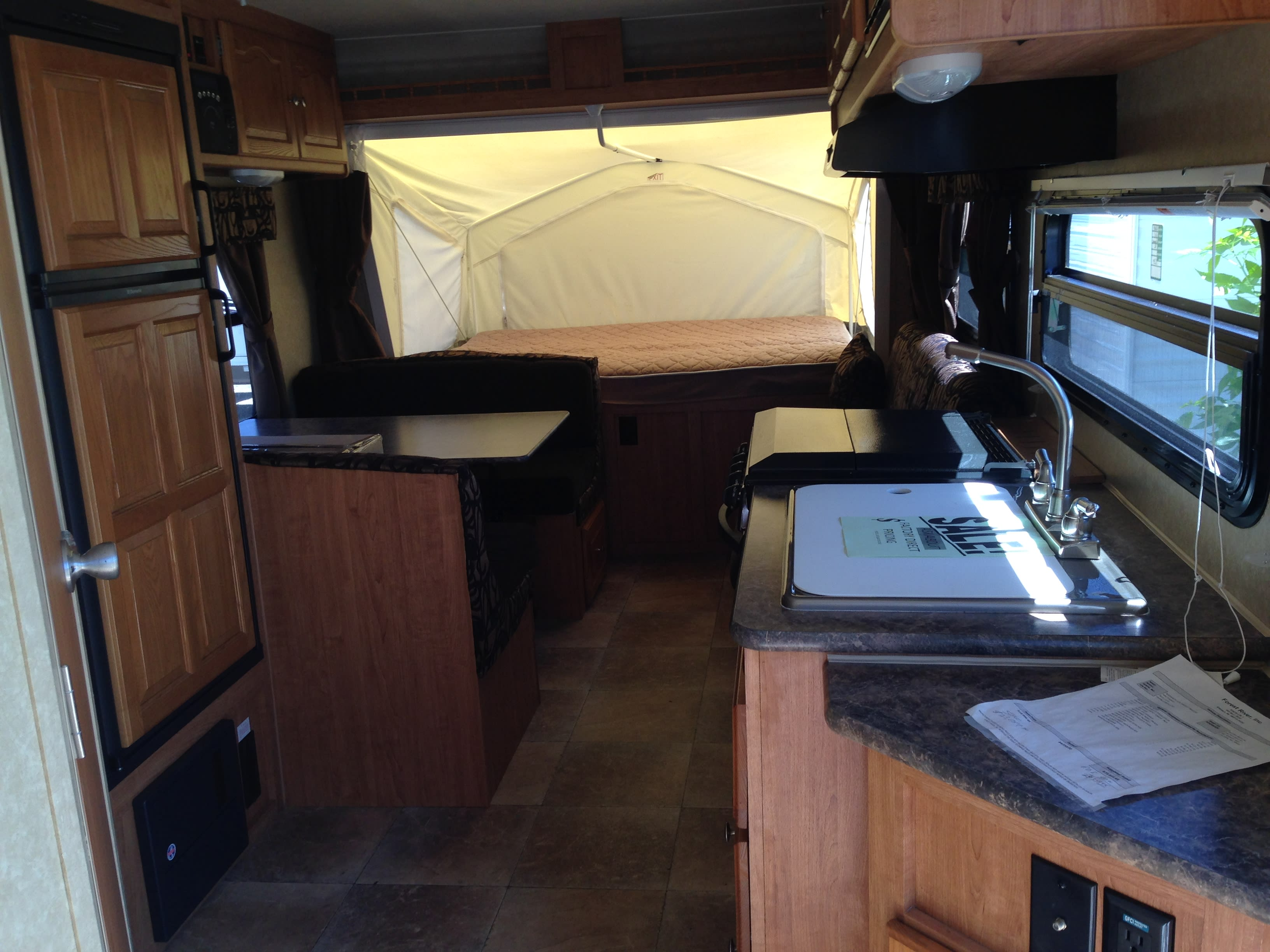 Extra sleeping...Dining table folds down into double bed.  Couch folds out into double bed.  . Rockwood Roo 19L 2011