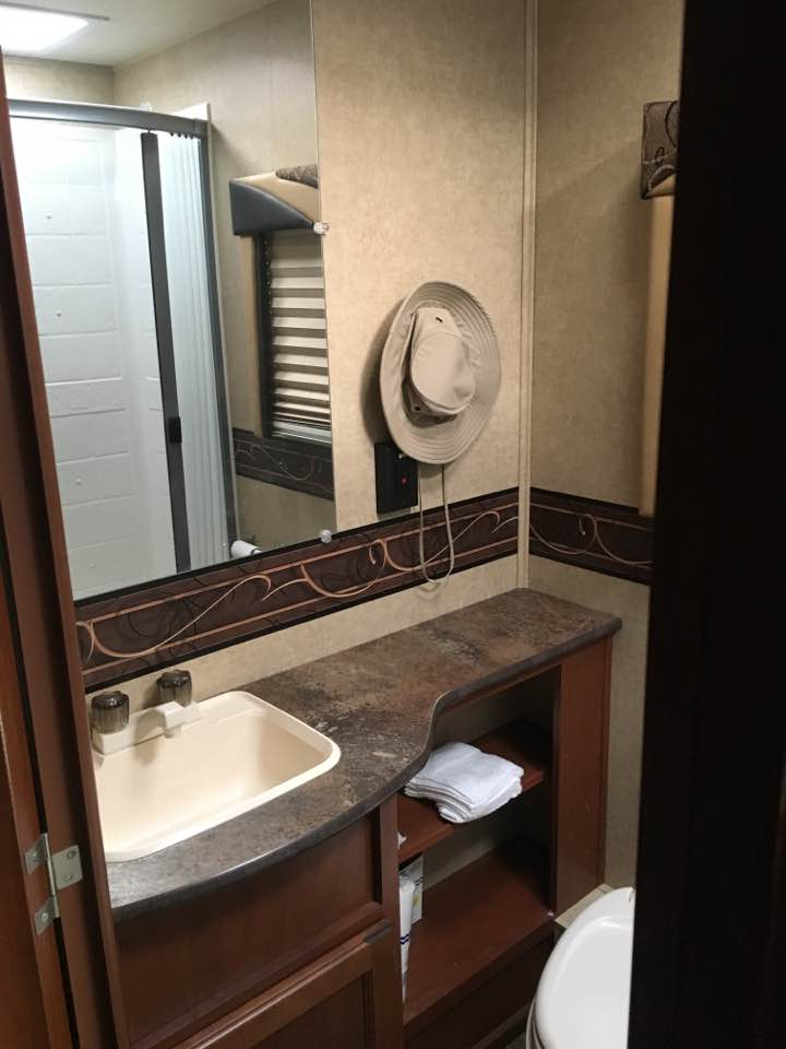 Bathroom - sink, vanity, toilet, full shower. Jayco Redhawk 2015