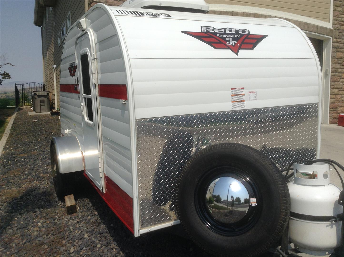 Spare Tire and full Propane tank. You will be the gem of the campground as people ask for peeks inside. :). Riverside Rv Whitewater Retro 2017