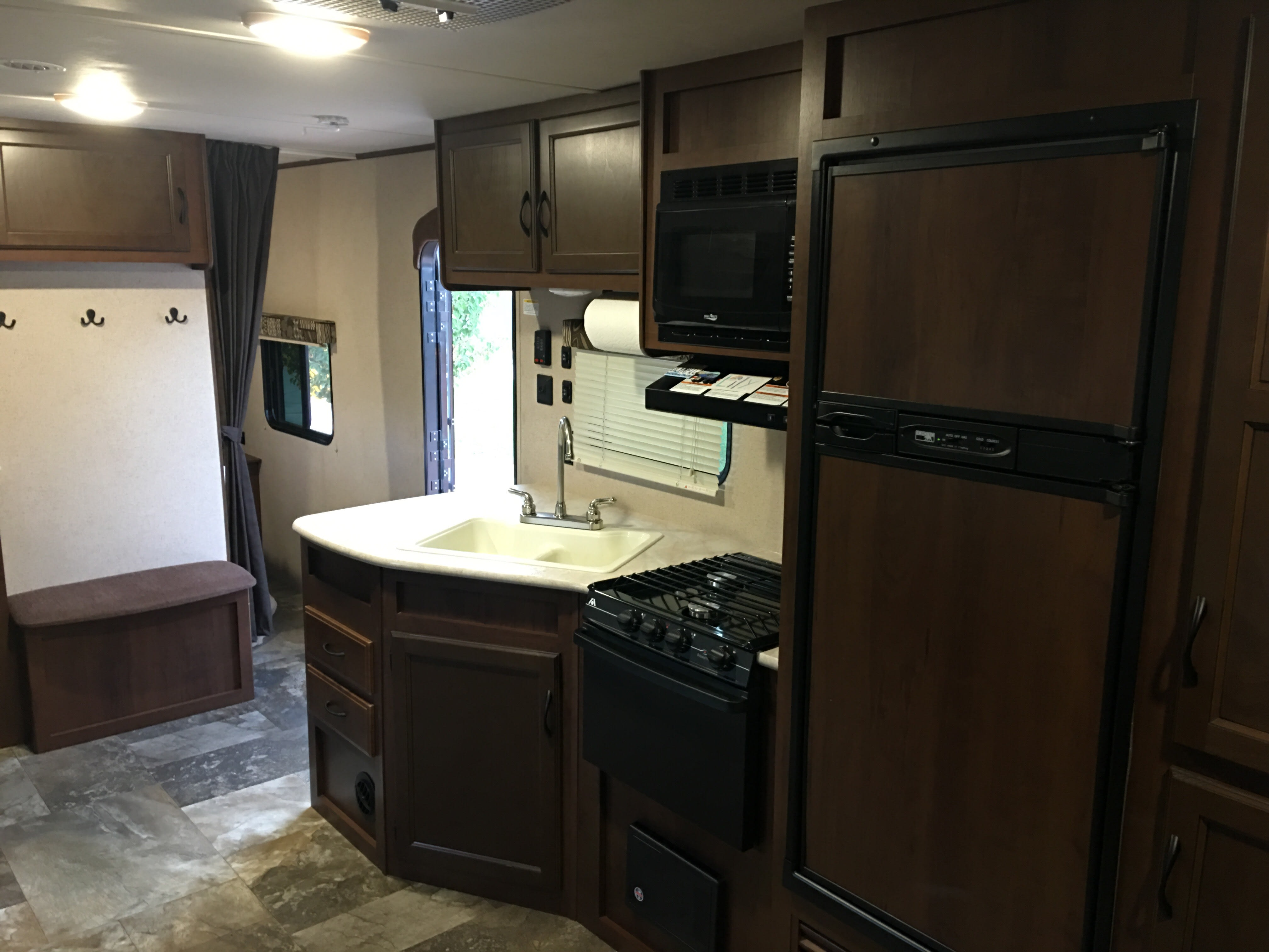 Kitchen area.  Microwave, 3 Burner Stove, Oven and Sink.  . Jayco Jay Flight 2015