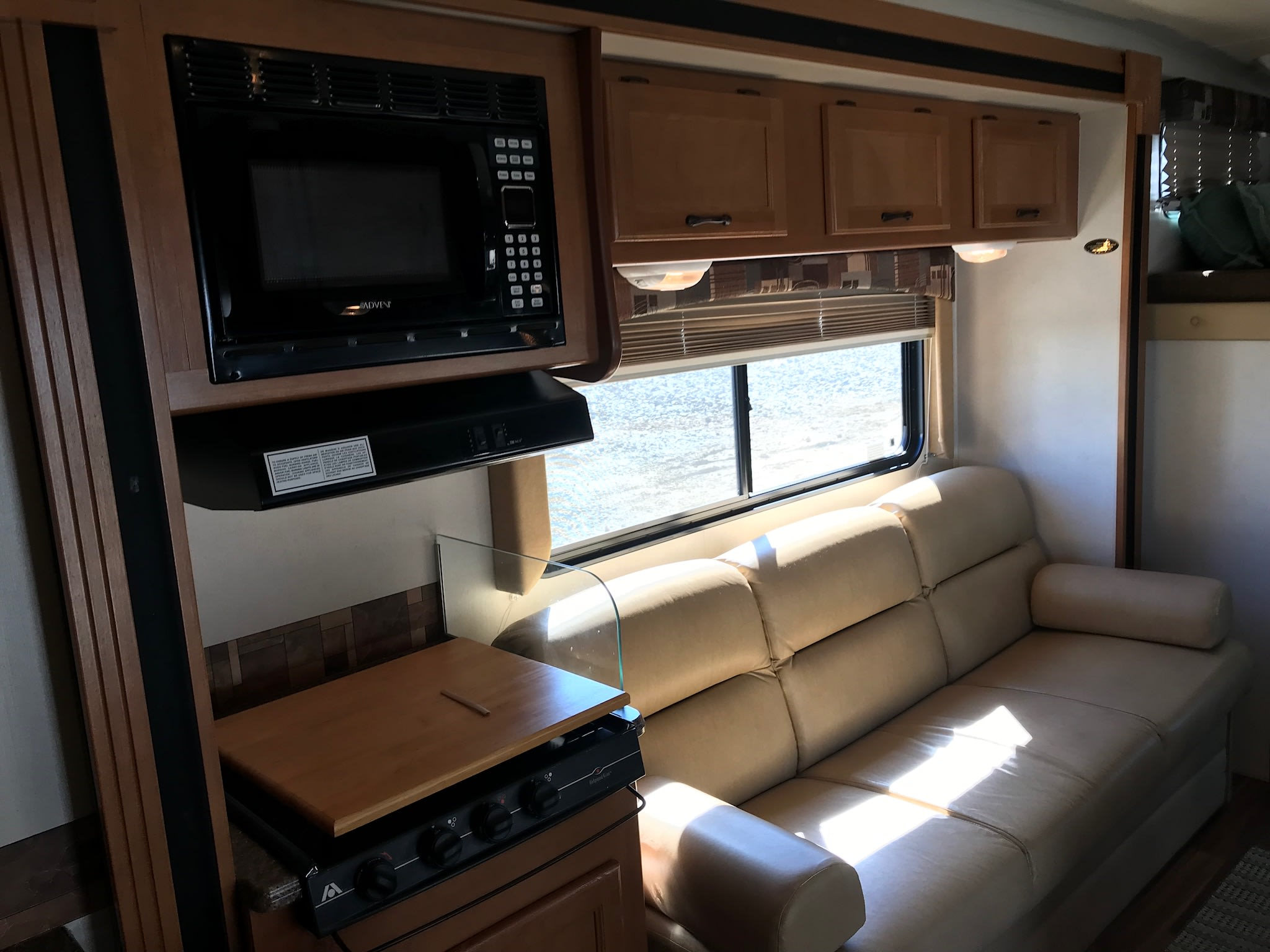 Stove top, Microwave, Sofa. Coachmen Freelander 2013