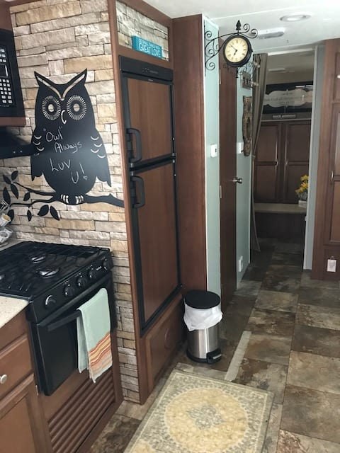 *Full kitchen with coffee maker, pots and pans, utensils and dishes, stove, oven, microwave, refrigerator/freezer. Coachmen Freedom Express 2015