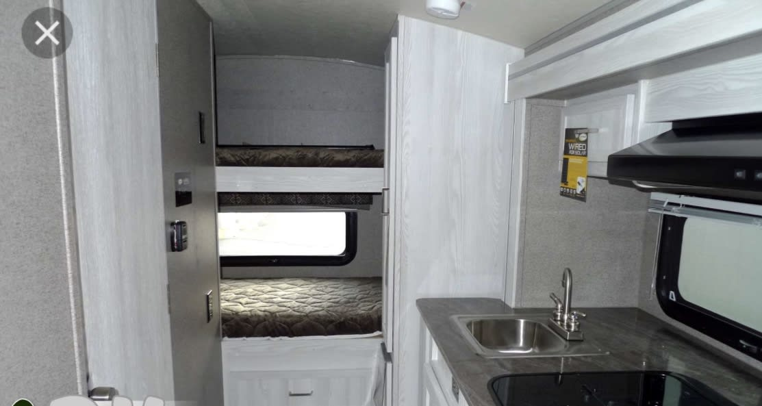 View of the bunk beds. Great window on the bottom bunk!. Forest River Flagstaff E-pro E16 2018