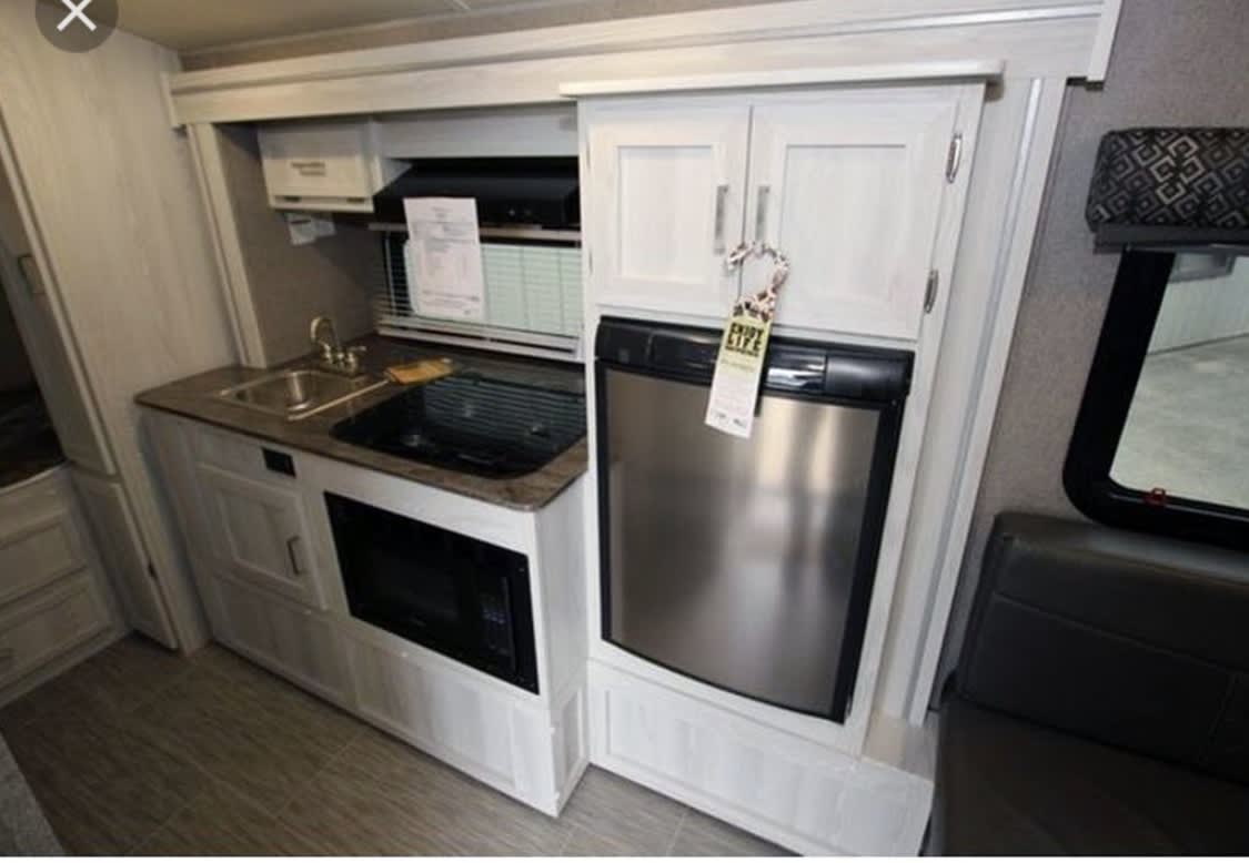 Gorgeous kitchen with great counter space and good size refrigerator.. Forest River Flagstaff E-pro E16 2018