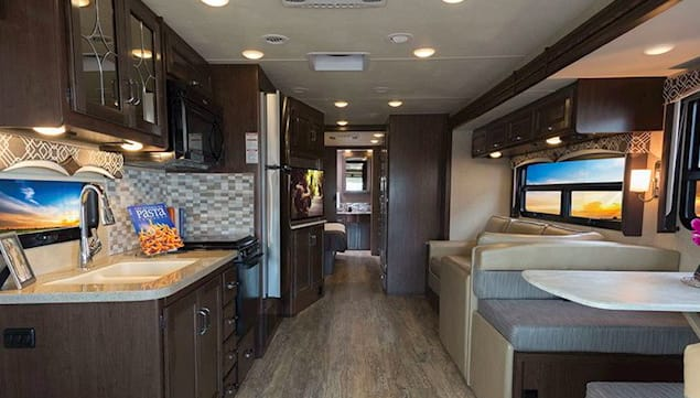 Main Cabin and Kitchen Residential fridge/freezer/ stove, microwave, oven with great pantry. Thor Motor Coach Hurricane 35M 2017