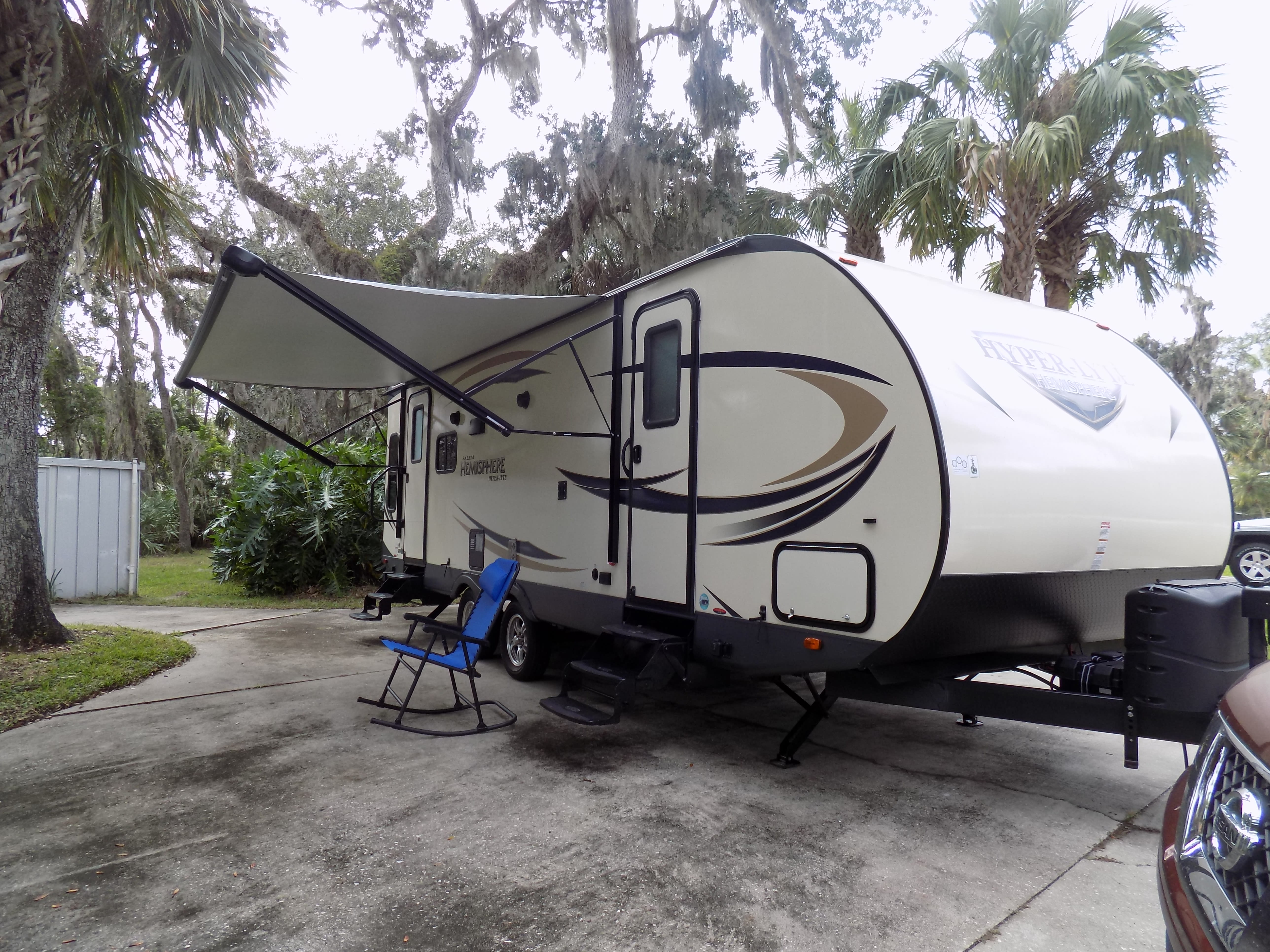 Left front showing 16 foot awning,exterior lighting, and speakers.. Forest River Hemisphere 2017