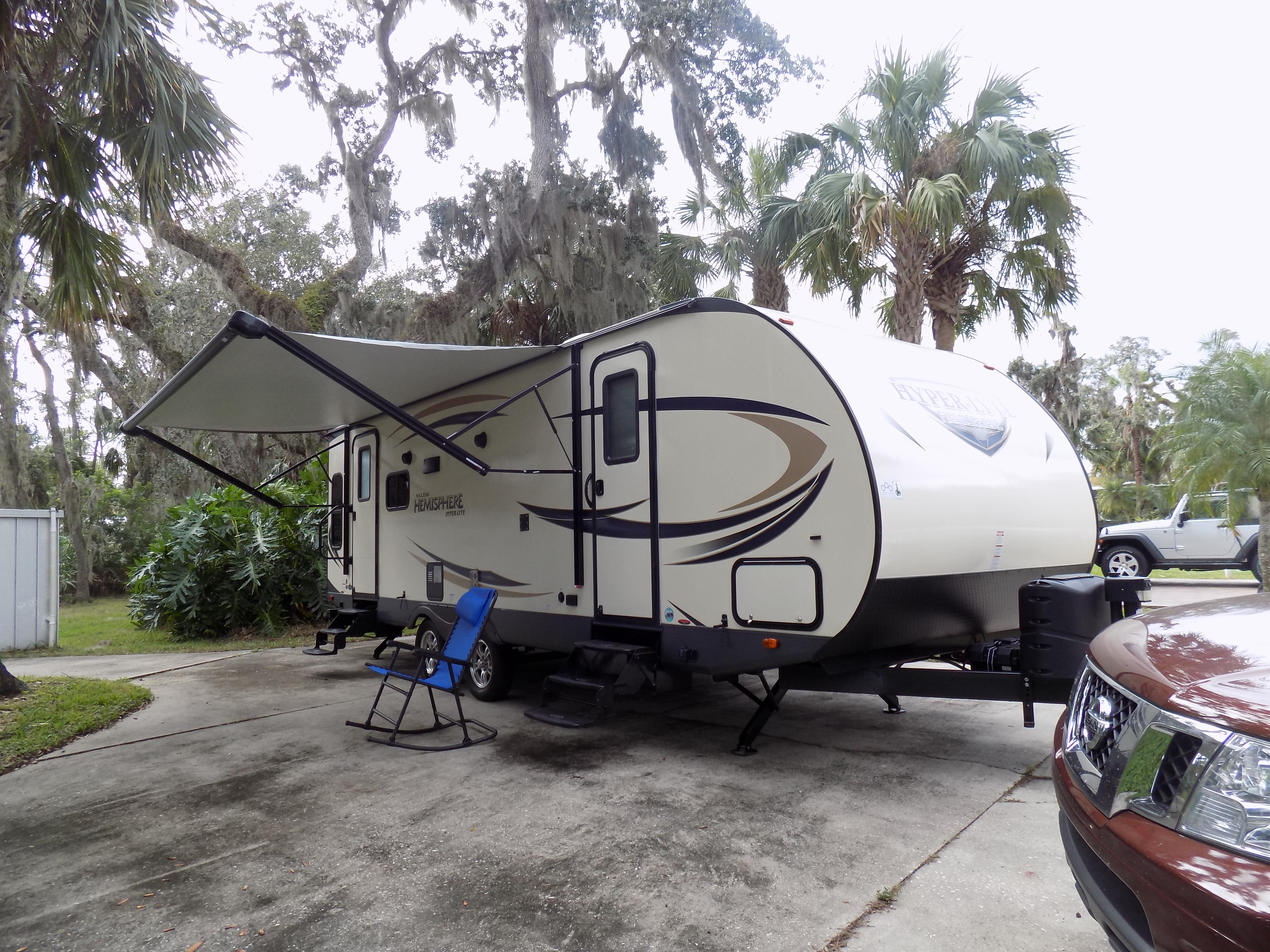 Left front showing 16 foot power remote awning , with lighting .. Forest River Hemisphere 2017