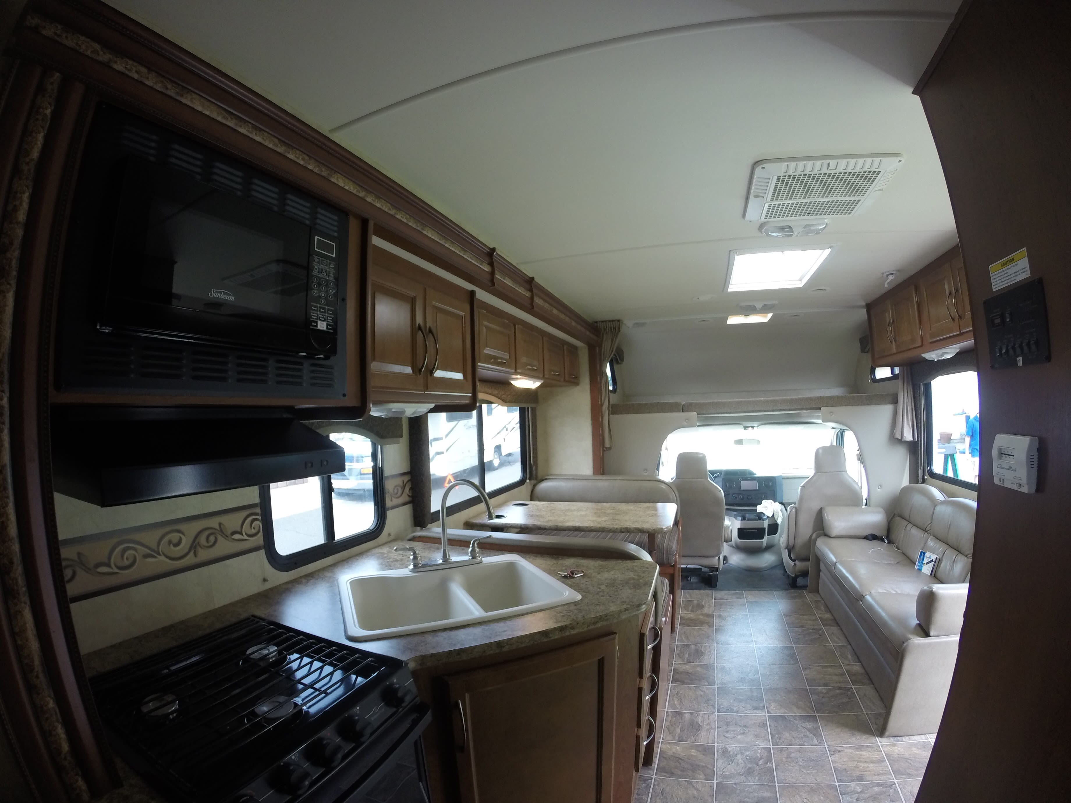 Don't discount the importance of this large shared family space for dinner or a movie... or dinner and a movie!. Thor Motor Coach Four Winds 2012