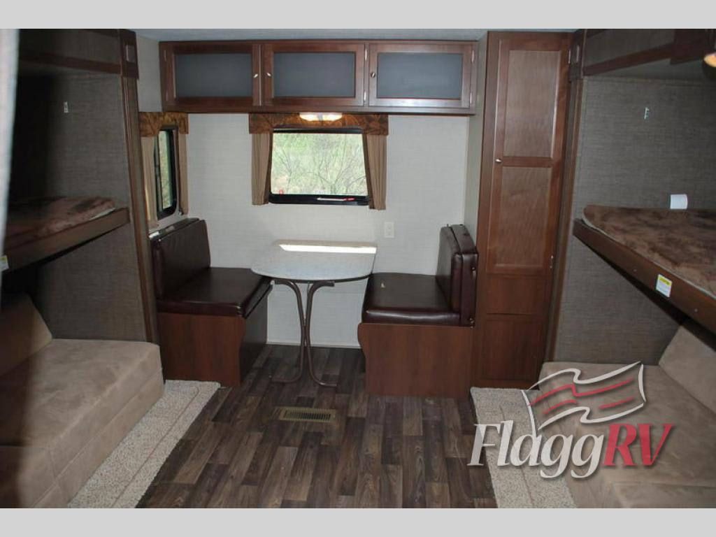 Teen suite in rear of camper comprised of dual pull-outs creating a large space for the kids to hang out. Not shown in the picture is the flat screen TV location.. Keystone Bullet 2016