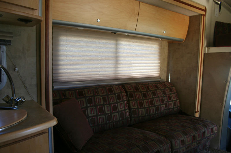 Couch turns into bed. Itasca Navion 2007