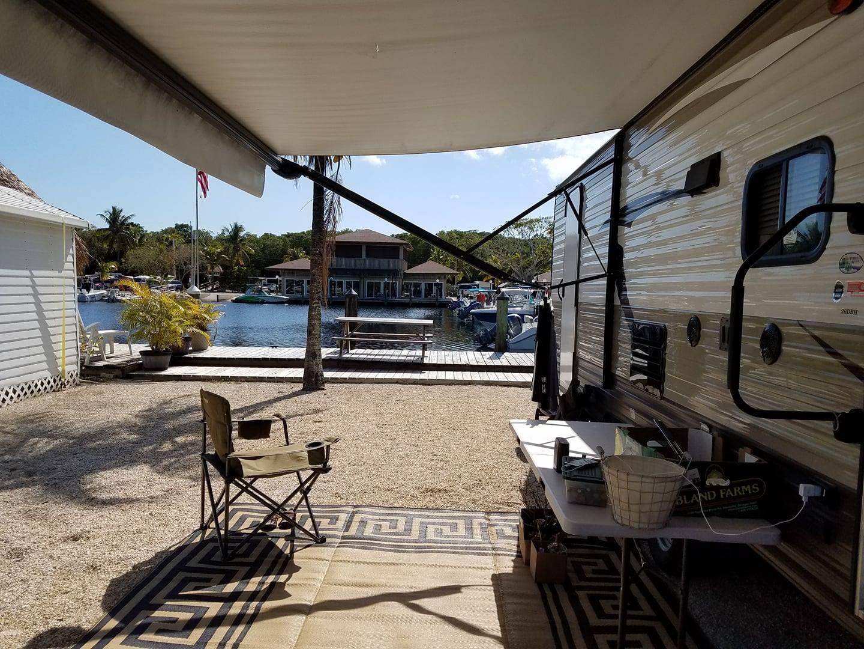 Trailer set up at an oceanside marina in Key Largo, Florida.. Forest River Patriot Edition 2016