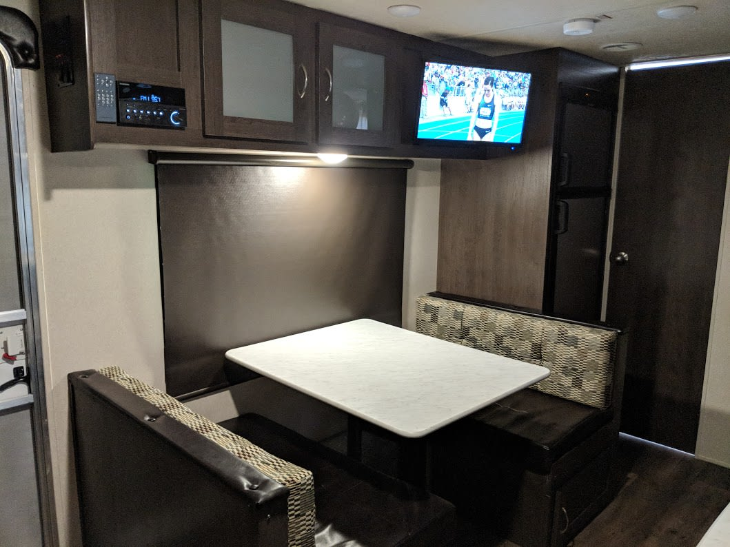 Dinette that folds into a sleeping area.  Two children could fit here or 1 adult. . Forest River Wildwood X-Lite 2019