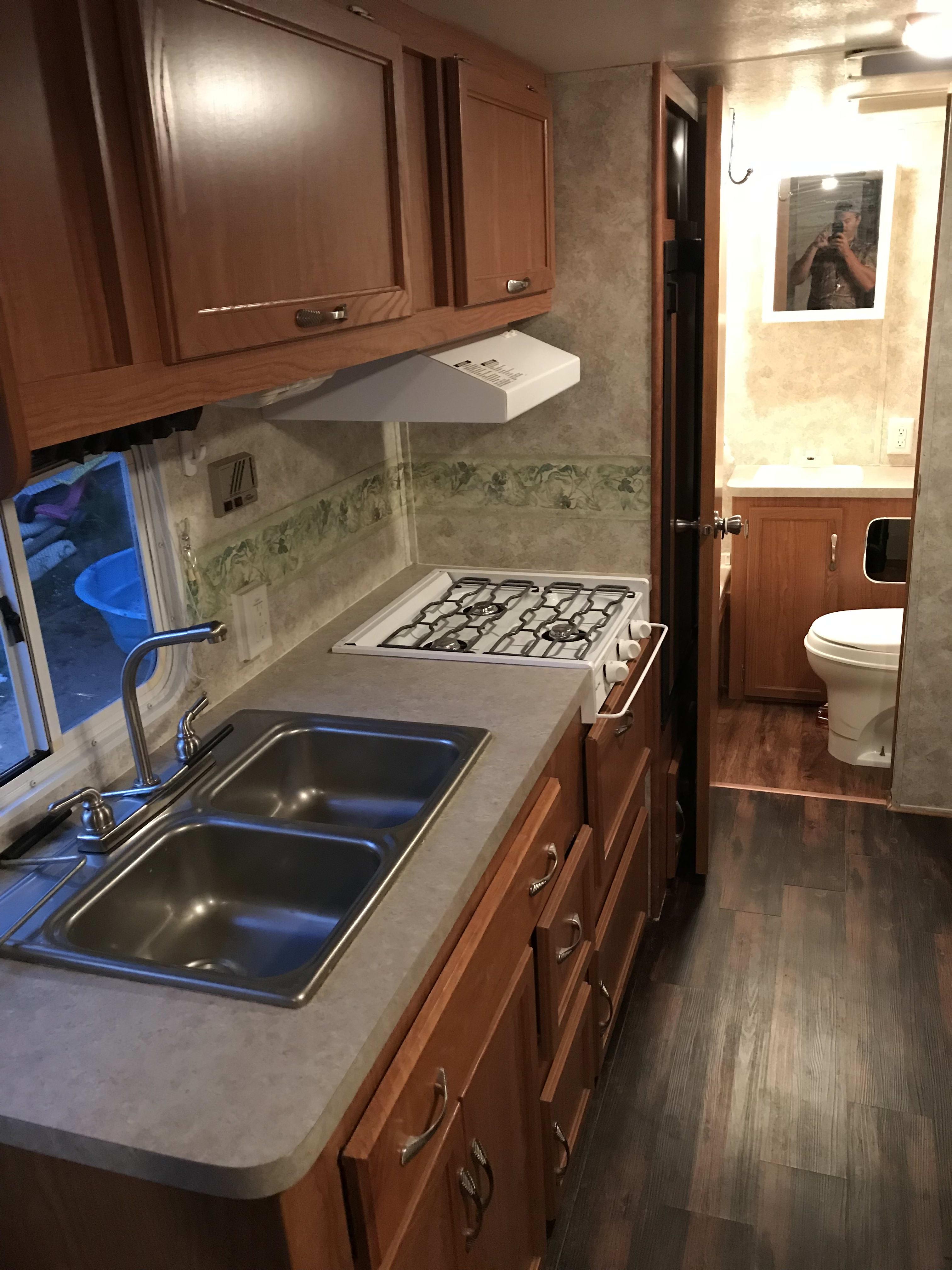 Kitchen and Bathroom. Coachmen Spirit Of America 2004