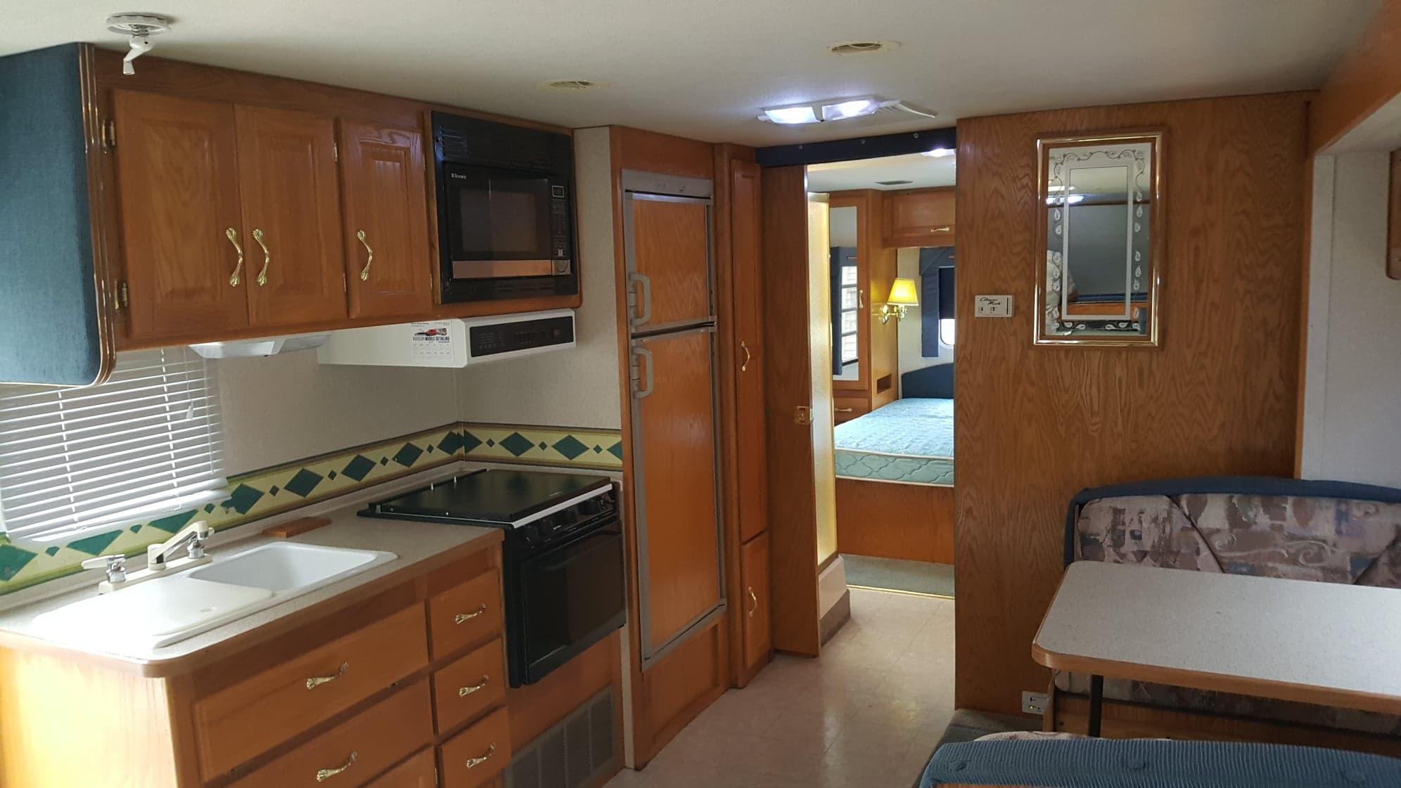 Kitchen area with nice size fridge.  . Gulf Stream Yellowstone 2000