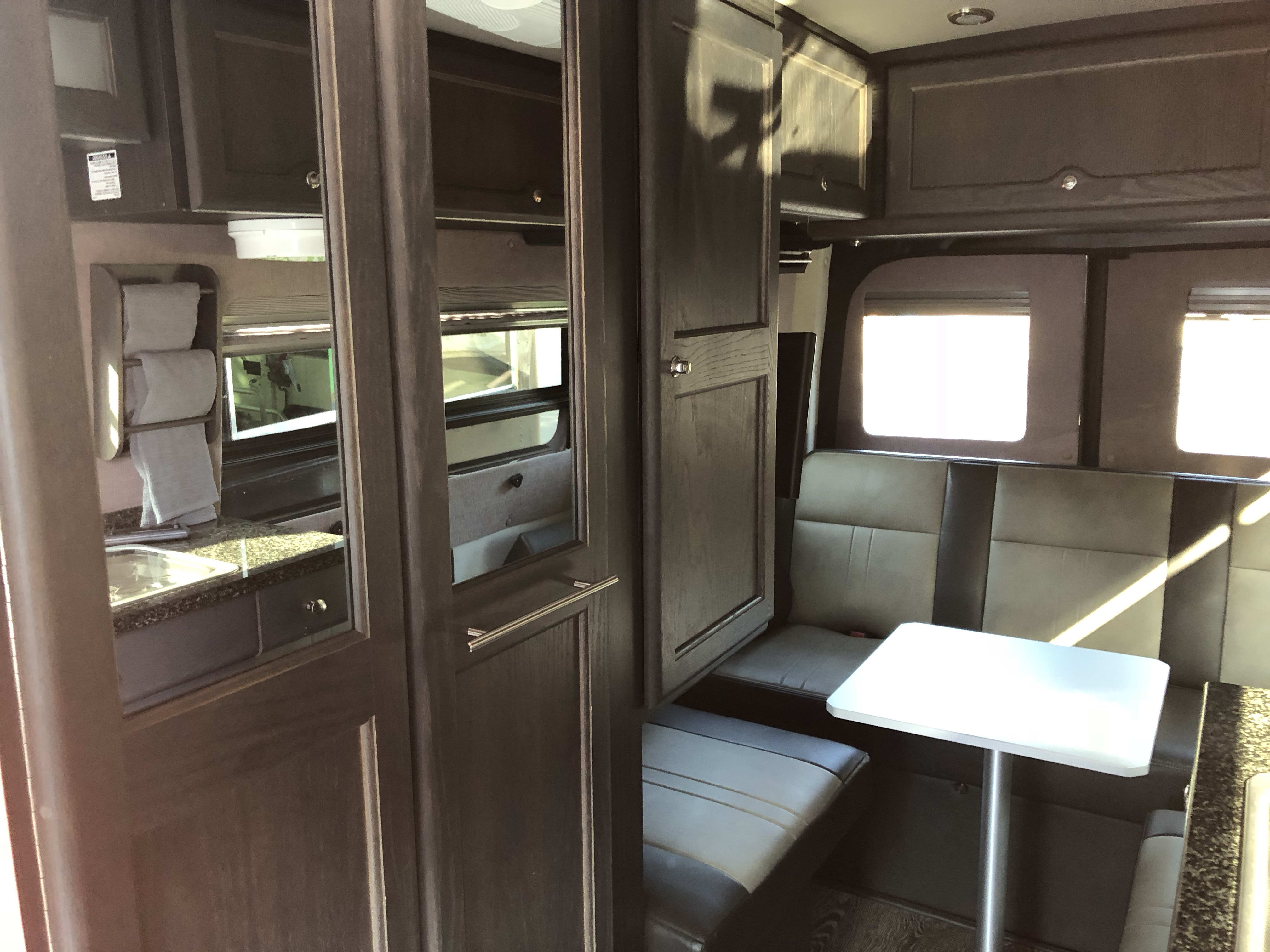 Passenger side inside facing rearward. Shower/bathroom doors are mirrored.. Mercedes Roadtrek SS Agile 2015