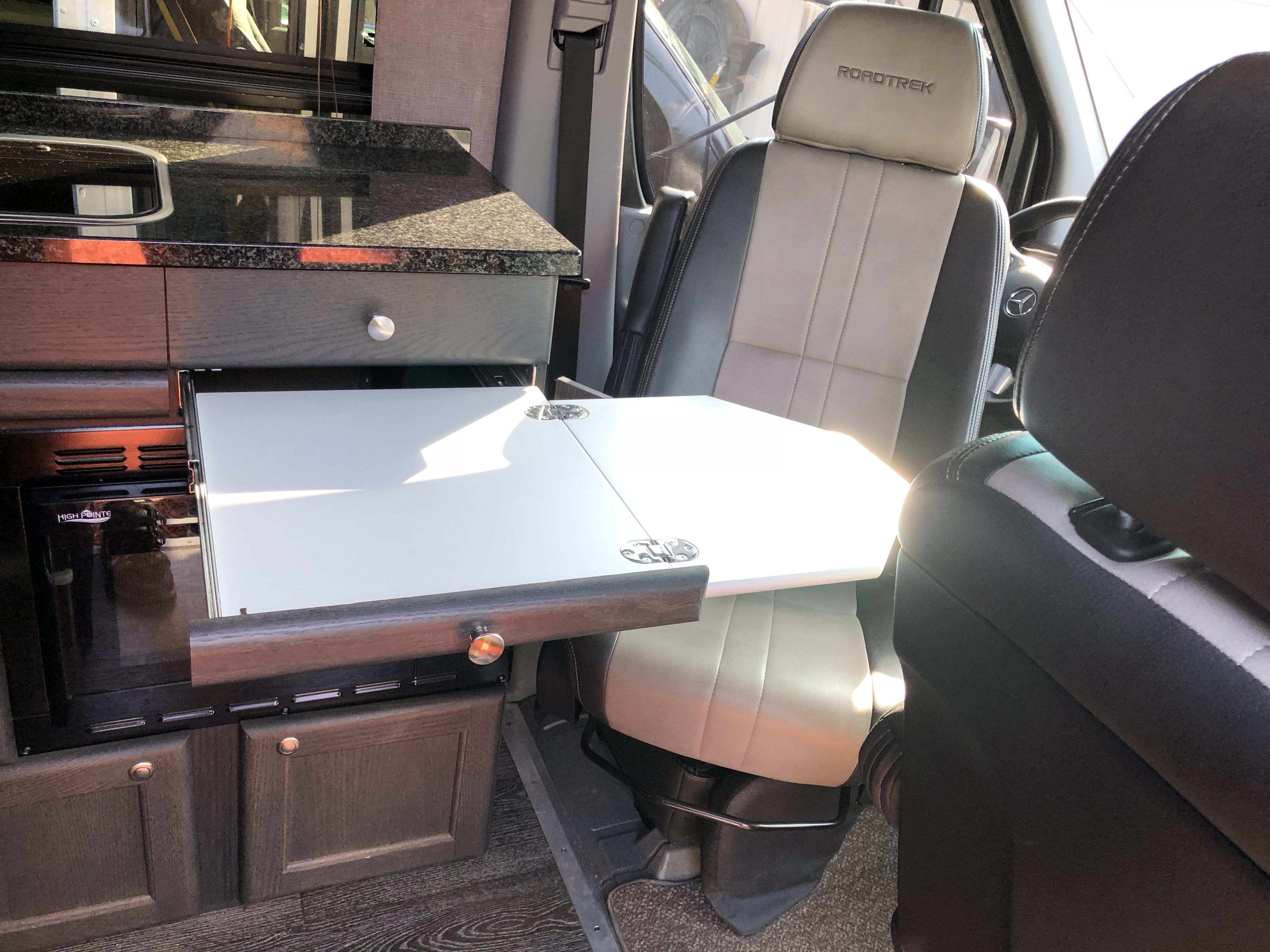 Driver's seat swiveled to pop out desk.. Mercedes Roadtrek SS Agile 2015