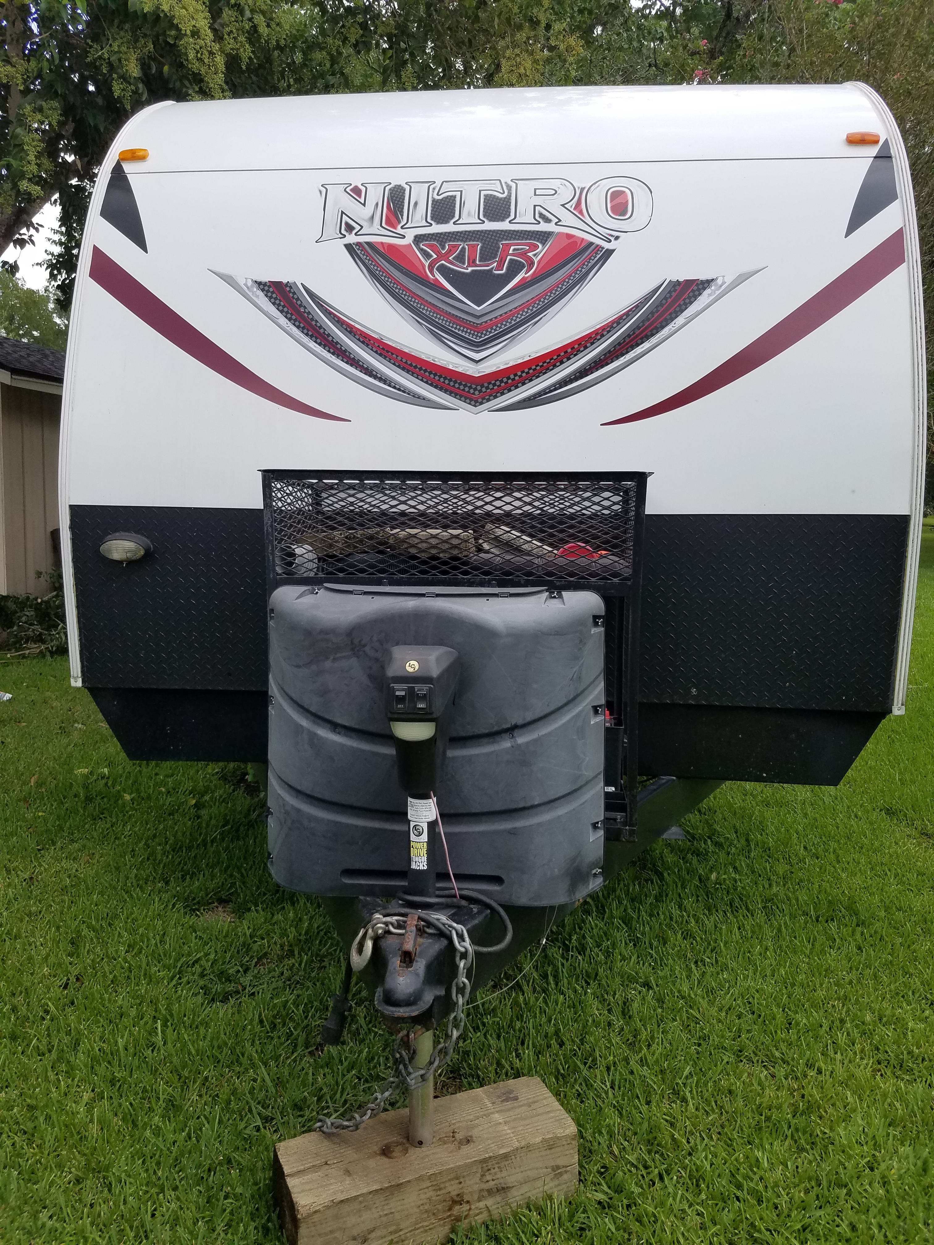 automatic trailer jack for easy hitching and unhitching.. forest river nitro xlr 2013