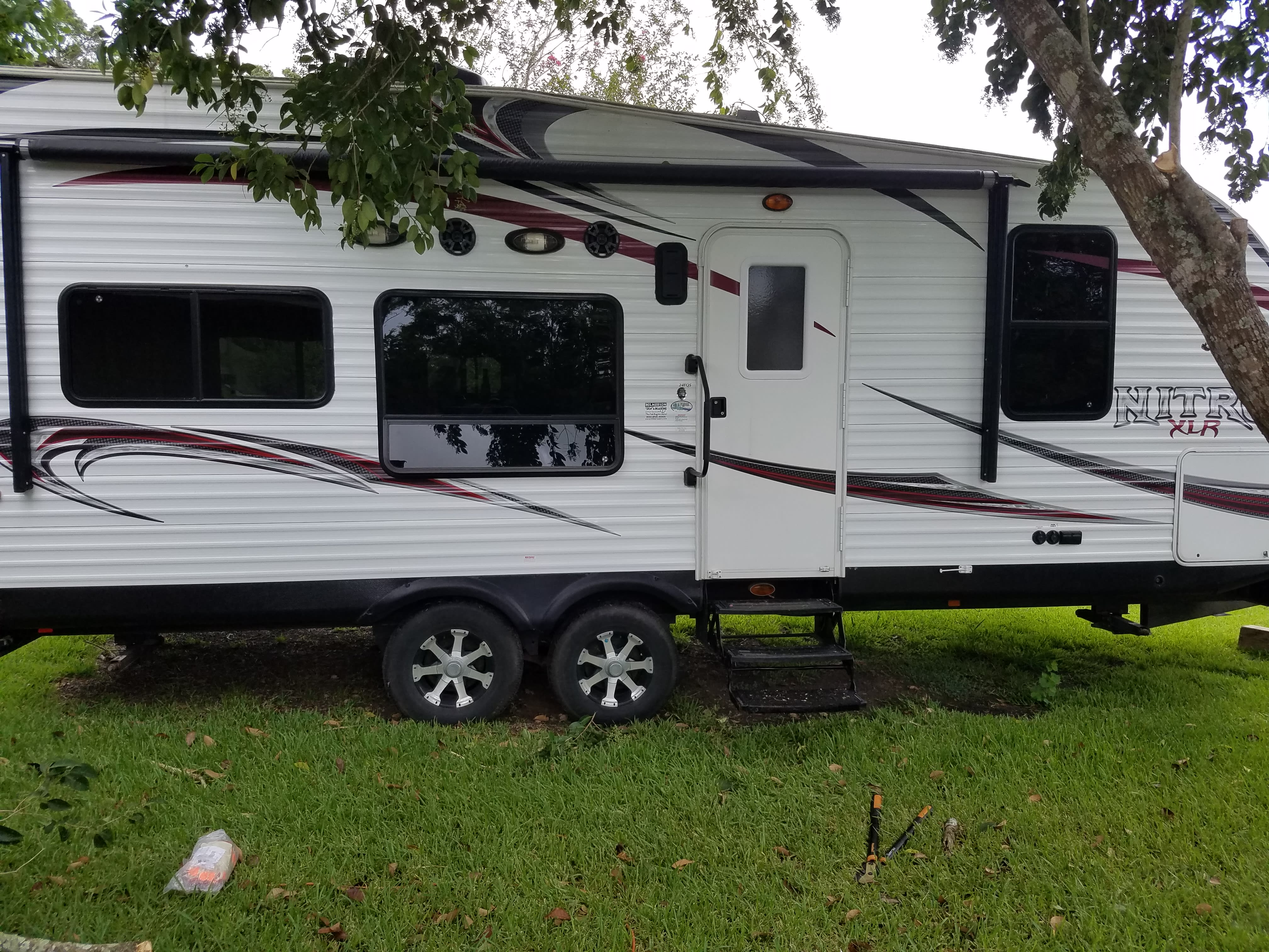 exterior speakers and an automated awning make for a great outside setting. plus outside plugs to hook up a fan to beat the heat!. forest river nitro xlr 2013