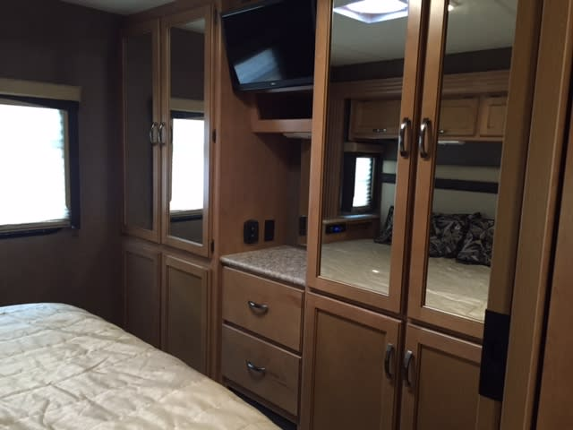 King bed and lots of accessible closet space. TV . * the back 2 bottom doors are not closet space.  . Thor Motor Coach A.C.E 27.1 2015
