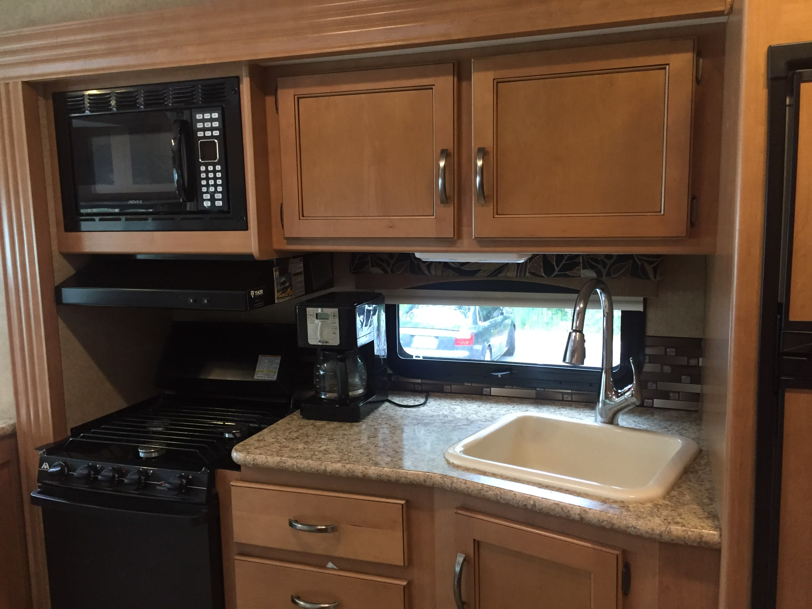 Outfitted with crock pot, induction hot plate, and coffee pot as well as all standard supplies at no additional charge.  NO sharp knives provided.. Thor Motor Coach A.C.E 27.1 2015