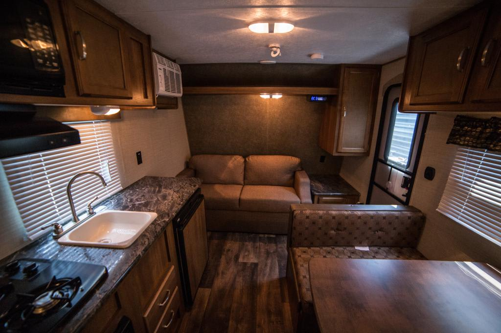 Travel Trailer Interior and Loveseat. Keystone Summerland 2017