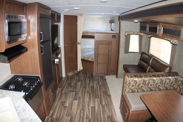Check out the HUGE living, cooking and dining area in our trailer.  The bunk room is at the rear of the photo to the right.  The bath is through the door at the left rear of the photo.. Keystone Hideout 2017