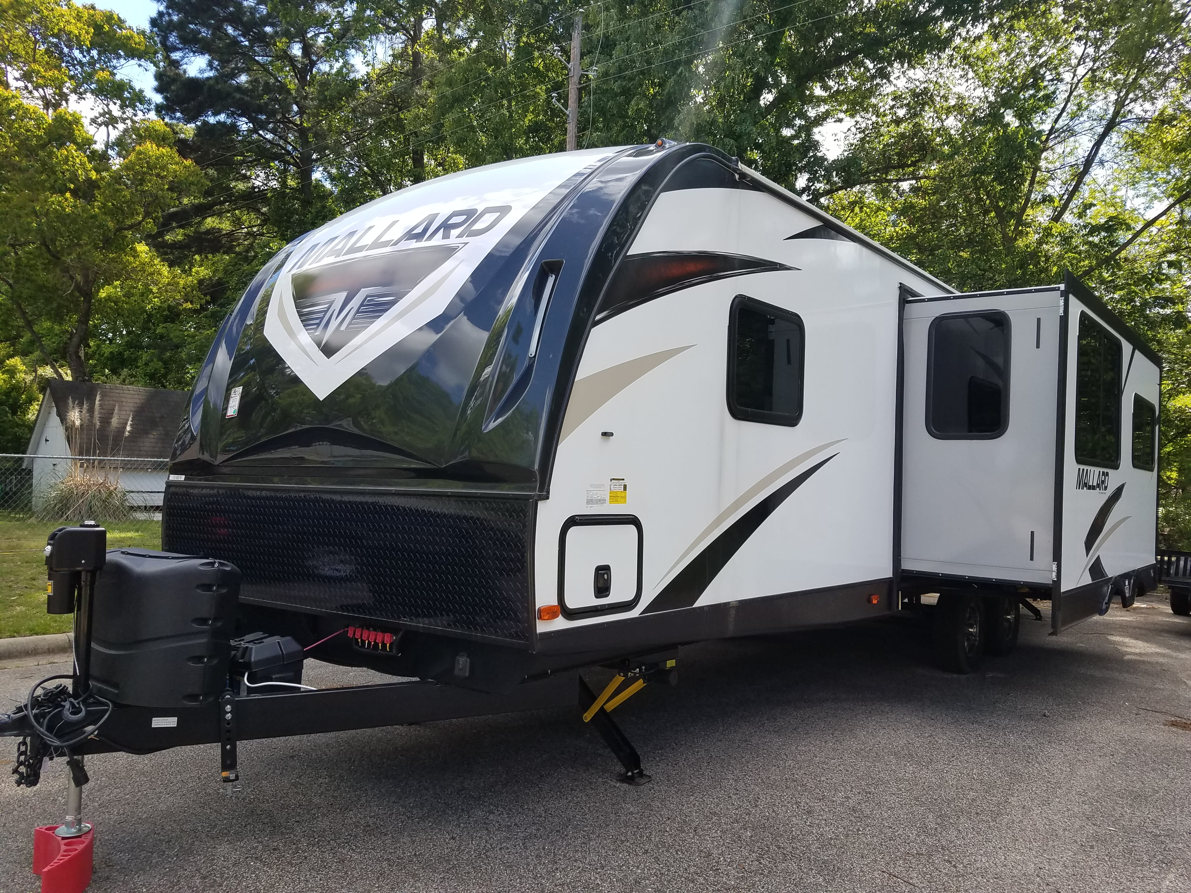 Slide-out with front and rear storage access.. Heartland Mallard 2018