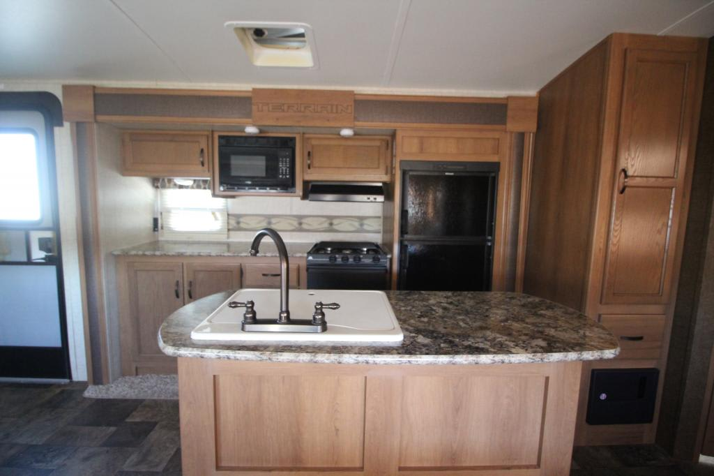 Beautiful Kitchen built into the slide out to provide extra living space. . Keystone Outback Terrain 2014
