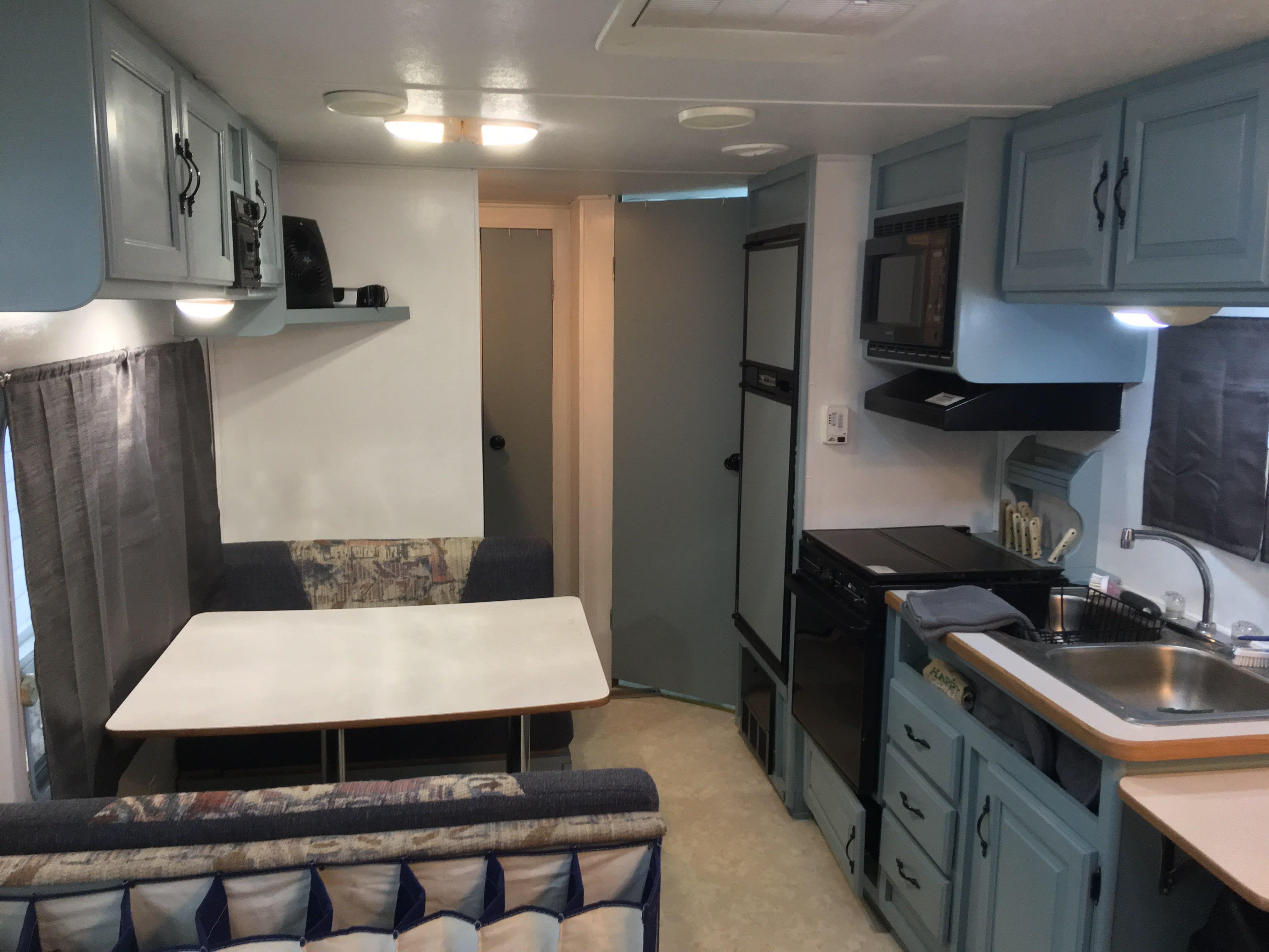Kitchen and dinette table.. Dutchmen Aerolite 2000