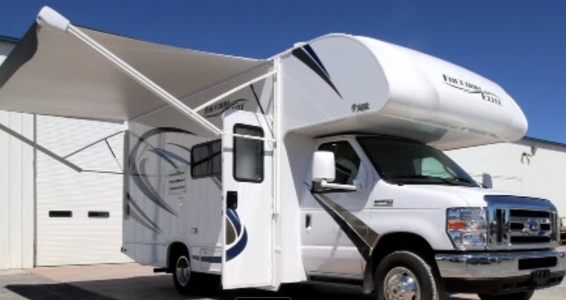 Right side showing awning extended with door open. Thor Motor Coach Freedom Elite 2019